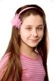 La jolie fille dans l'âge d'onze a isolé sur le blanc Photos stock