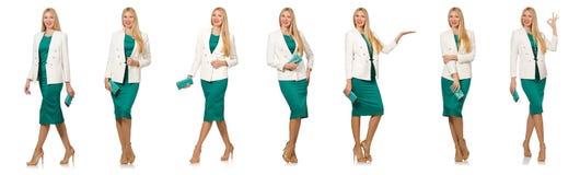 La jolie jeune femme dans la robe verte d'isolement sur le blanc Photos stock