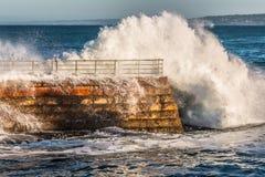La Jolla Children's Pool Seawall with Crashing Waves Royalty Free Stock Image
