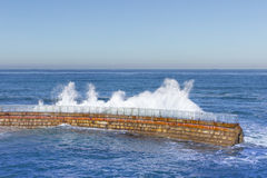 La Jolla Sea Wall with Crashing Wave. Sea Wall getting a pounding during the King Tide Royalty Free Stock Image