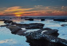 La Jolla Tidal Pools at Sunset. With Orange Sky and Blue water stock image