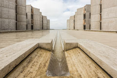 La Jolla, USA - December 10, 2015: Symmetrical architecture of the Salk Institute in San Diego with fountain vanishing point Stock Photos