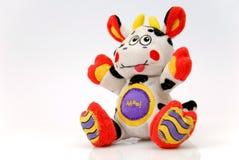 La joyeuse vache le jouet Photos libres de droits
