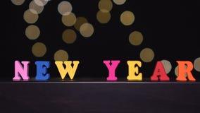 La línea del arrastramiento con poner letras a Feliz Año Nuevo contra la falta de definición enciende el fondo metrajes