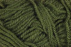 La laine fine verte naturelle filète la texture, macro modèle de fond de plan rapproché de boucle texturisée horizontale Photo libre de droits