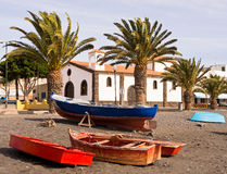 Fishing Village Fuerteventura Canary Islands Spain. Fishing boats on the beach in La Lajita village, with a church in the background. Fuerteventura, Canary royalty free stock images