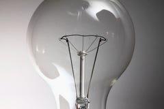 La lampadina sui precedenti bianchi Fotografia Stock Libera da Diritti
