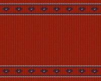 La lana ha tricottato il modello con i cuori blu su fondo rosso Fotografie Stock Libere da Diritti