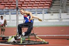 La lancée de disque des hommes pour les personnes handicapées Photos libres de droits