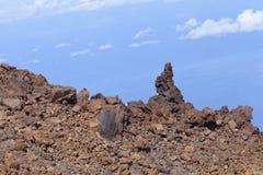 La lava vulcanica oscilla nel parco nazionale di EL Teide, Tenerife Immagine Stock