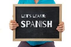 La lavagna con ci ha lasciati imparare il testo spagnolo immagini stock libere da diritti