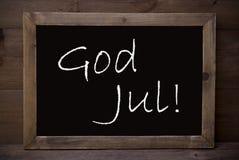 La lavagna con Dio luglio significa il Buon Natale Immagini Stock Libere da Diritti