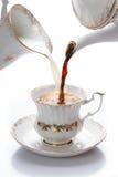 La leche y el café vertieron una taza Imagen de archivo libre de regalías