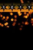 La lente anaranjada brillante señala por medio de luces fondo - Año Nuevo 2017 Fotografía de archivo libre de regalías