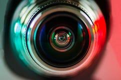 La lente de cámara y el contraluz rojo-verdes Imágenes de archivo libres de regalías