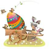 La lepre di pasqua è fortunata il carretto con un uovo di Pasqua Fotografie Stock