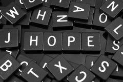 La letra negra teja el deletreo de la palabra y del x22; hope& x22; Fotos de archivo libres de regalías