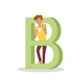 La letra y el muchacho de B escucha la música en el teléfono móvil Foto de archivo libre de regalías