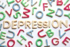 La lettera normale ha modellato la DEPRESSIONE dei biscotti fra quelle colourfully decorate Fotografia Stock Libera da Diritti