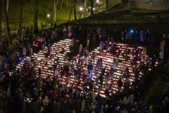 La Lettonia celebra il giorno di Lacplesa 11 novembre Fotografia Stock