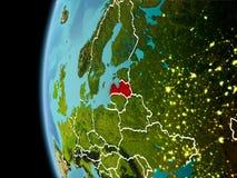 La Lettonia da spazio nella sera Fotografia Stock Libera da Diritti