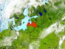 La Lettonia sulla mappa con le nuvole Fotografia Stock