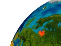 La Lettonie sur le globe Photos stock