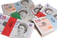 La libra de Britsh observa el dinero del dinero en circulación Imagen de archivo libre de regalías