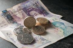 La libra esterlina y las monedas sueltan el dinero Imagen de archivo libre de regalías