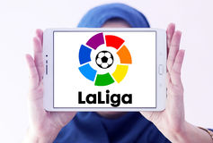 La liga, spanish league logo. Logo of La liga, spanish league on samsung tablet holded by arab muslim woman stock photo