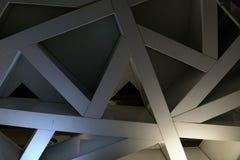 La ligne métal de fond de triangle donne à q une consistance rugueuse W Photographie stock libre de droits