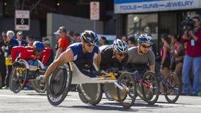 La lila Bloomsday 2013 12k corre en la división de la silla de ruedas de los hombres de Spokane WA Foto de archivo libre de regalías