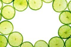 La limette verte découpe le fond en tranches Photographie stock
