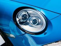 La linterna de un conductor veloz de Porsche 911 imagenes de archivo