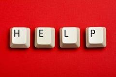 La llave de ayuda cierra el teclado de ordenador Fotografía de archivo libre de regalías