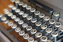 La llave a la máquina de escribir Fotos de archivo