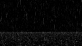 La lluvia el caer con salpica y espuma en la capa del bucle de tierra metrajes