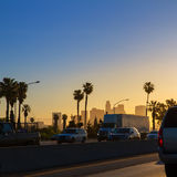 LA Los Angeles sunset skyline with traffic California. From freeway royalty free stock photography