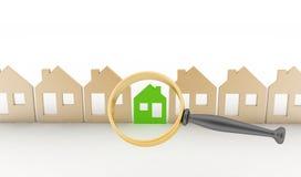 La loupe sélectionne ou inspecte une eco-maison dans une rangée des maisons Images libres de droits