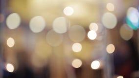 La lumière abstraite de Bokeh, célèbrent rougeoyer de scintillement de bokeh d'ampoule de décoration, de lumière de Noël, la tach banque de vidéos