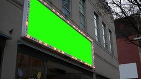 La lumière verte d'écran signent au-dessus des affaires banque de vidéos