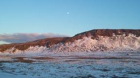 La lune dans le soleil de minuit Image libre de droits
