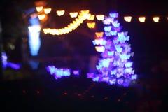 La luz, mariposa hermosa del bokeh formó y falta de definición en la noche Fotografía de archivo libre de regalías