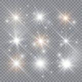 La luz que brilla intensamente estalla en un fondo transparente P?rticulas de polvo m?gicas chispeantes Estrella brillante Ilustr foto de archivo libre de regalías