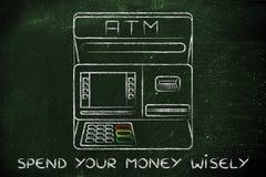 La máquina de caja automática con la escritura gasta su dinero sabiamente Imagen de archivo libre de regalías