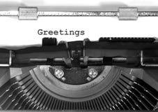 La máquina de escribir mecanografía el primer de los saludos Fotos de archivo