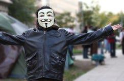 La máscara anónima encendido ocupa al manifestante de la C.C. Foto de archivo libre de regalías