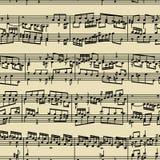 La música observa el manuscrito Imagen de archivo