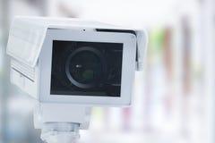 La macchina fotografica o la videocamera di sicurezza del Cctv sul dettagliante ha offuscato il fondo Fotografie Stock