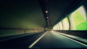 la macchina guida in un tunnel stock footage
